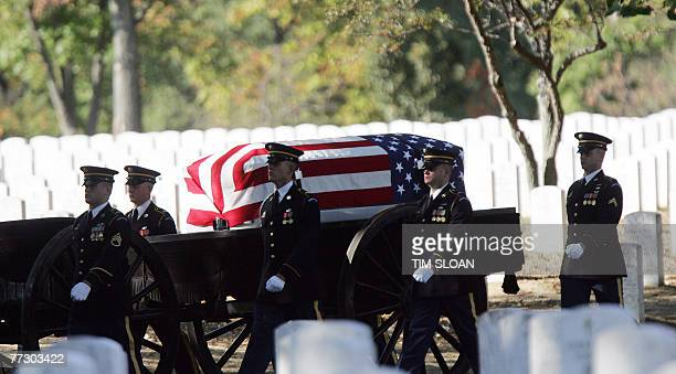 Soldiers from the US 3rd Infantry traditionally known as the Old Guard escort the remains of 12 US army soldiers killed when their UH60 Black Hawk...