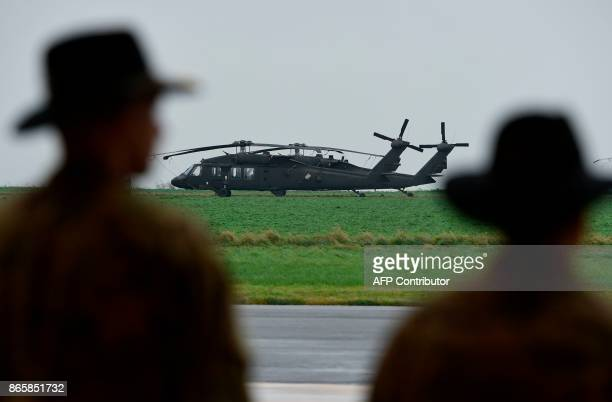 Soldiers from the US Army 1st Cavalry Brigade 1st Cavalry Division stand in front of UH60 Black Hawk helicopters on the tarmac at Shape Airfield at...