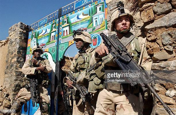 Soldiers from the U.S. Army 82nd Airborne Division conduct a sweep of homes November 2, 2002 in the village of Naray in southeastern Afghanistan. The...