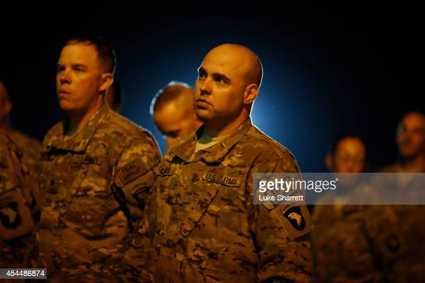 Soldiers from the US Army's 159th Combat Aviation Brigade 101st Airborne Division stand in formation before participating in a homecoming ceremony at...