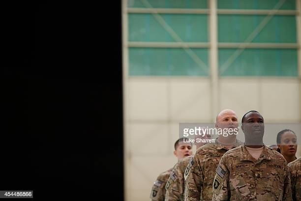 Soldiers from the US Army's 159th Combat Aviation Brigade 101st Airborne Division sing the 101st Airborne Division anthem during a homecoming...