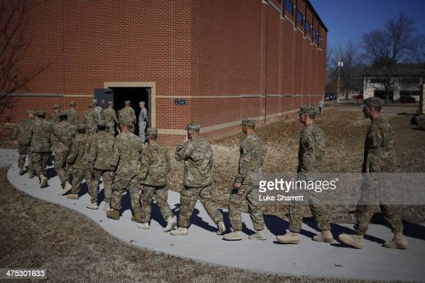 Soldiers from the US Army's 3rd Brigade Combat Team 1st Infantry Division arrive at a homecoming ceremony in the Natcher Physical Fitness Center on...