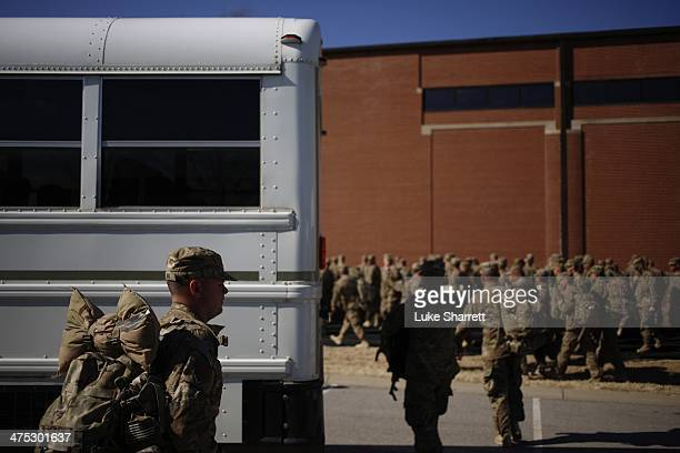 Soldiers from the US Army's 3rd Brigade Combat Team 1st Infantry Division arrive by bus to a homecoming ceremony in the Natcher Physical Fitness...