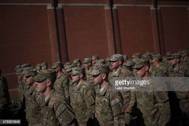 Soldiers from the US Army's 3rd Brigade Combat Team 1st Infantry Division stand in formation before participating in a homecoming ceremony in the...