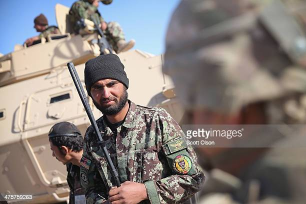 Soldiers from the U.S. Army's 4th squadron 2d Cavalry Regiment and the Afghan National Army prepare for a joint patrol on March 1, 2014 near...