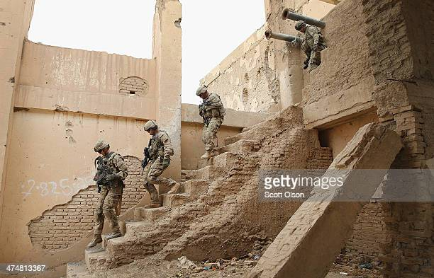 Soldiers from the US Army's 4th squadron 2d Cavalry Regiment visit an Afghan National Police outpost that was once home to Osama Bin Laden on...