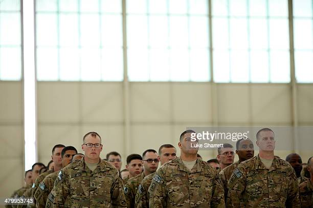 Soldiers from the US Army's Battery B 2nd Battalion 44th Air Defense Artillery Regiment 101st Airborne Division stand at attention during a...