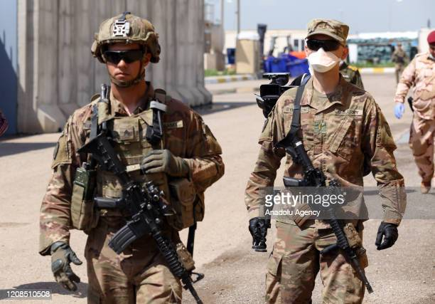 Soldiers from the US-led coalition forces are seen during the handover of the K1 Air Base to the Iraqi Army from the US-led coalition in Kirkuk, Iraq...