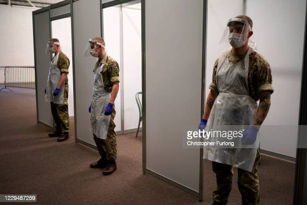 Soldiers from the Yorkshire Regiment prepare a mass Covid-19 testing site in the Liverpool Tennis centre at Wavertree Sports Park on November 6, 2020...