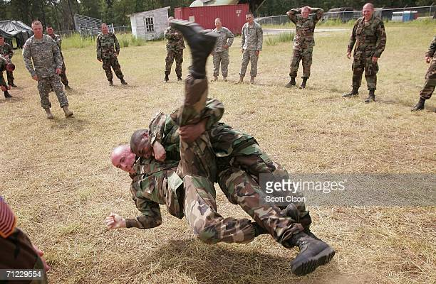 Soldiers from various Army reserve Military Police units train how to react to an attack by a prisoner in a detention center during the Patriot...