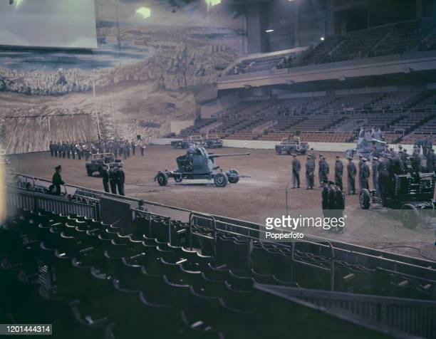 Soldiers from various regiments of the British Army rehearse with mobile artillery prior to taking part in the 1957 Royal Tournament military tattoo...