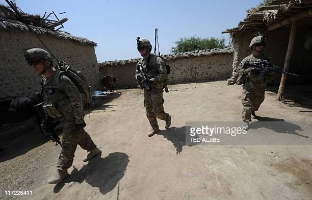 US soldiers from Viper Company 126 Infantry search a house for arms and ammunitions at a village at Combat Outpost Sabari in Khost province in the...