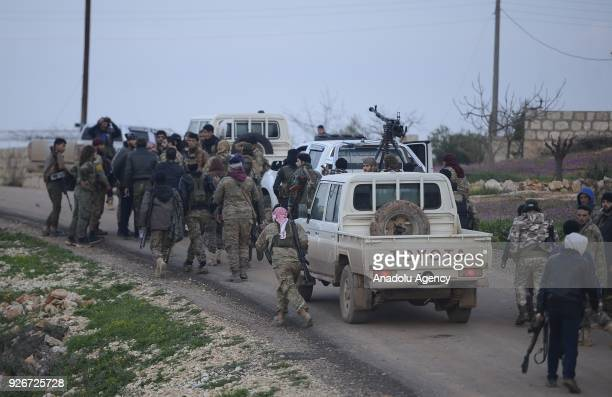 Soldiers gather after Free Syrian Army and Turkish Army cleared Ali Bazan Qariqin and Shamanli villages of Sharan district northeast of Afrin from...