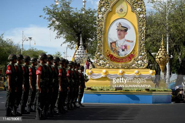 Soldiers gather in front of a portrait of Thailand's King Maha Vajiralongkorn in Bangkok on May 2 ahead of the royal coronation which will take place...