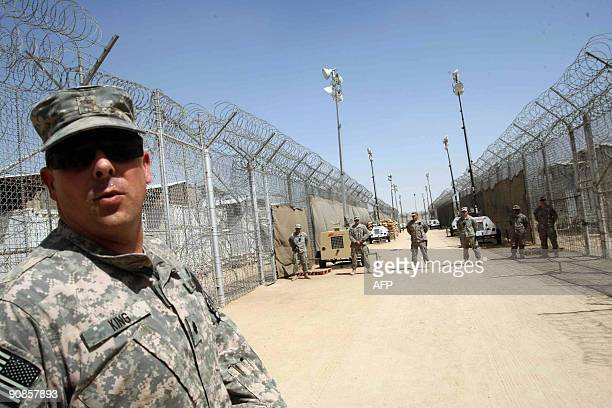 US soldiers guard Camp Bucca prison on the outskirts of the southern city of Basra 550 kms from Baghdad on September 16 2009 The USrun prison will...