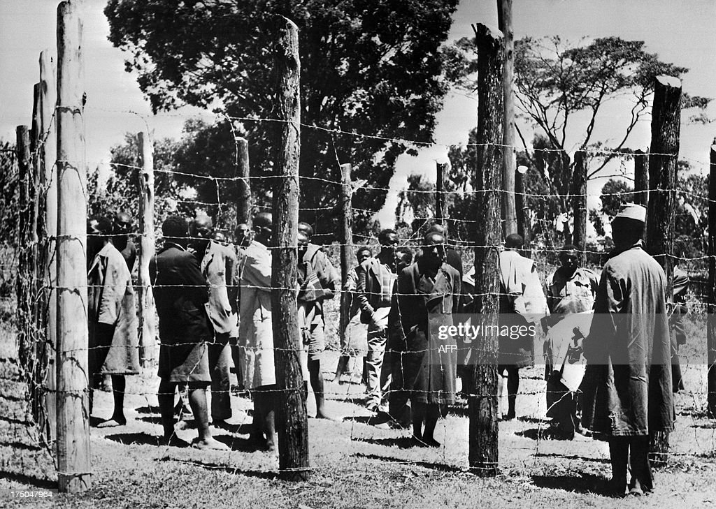 Soldiers guard Mau Mau fighters behind barbed wires, in October 1952, in the Kikuyu reserve. Mau Mau, members of Kikuyu ethnic tribe, fought from October 1952 to december 1959 against the British colonial rule in kenya.