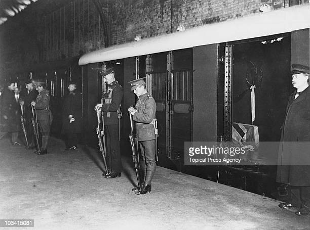 Soldiers guard the coffin of the Unknown Warrior, after it was brought to the UK from France, 11th November 1920. The remains of an unidentified...
