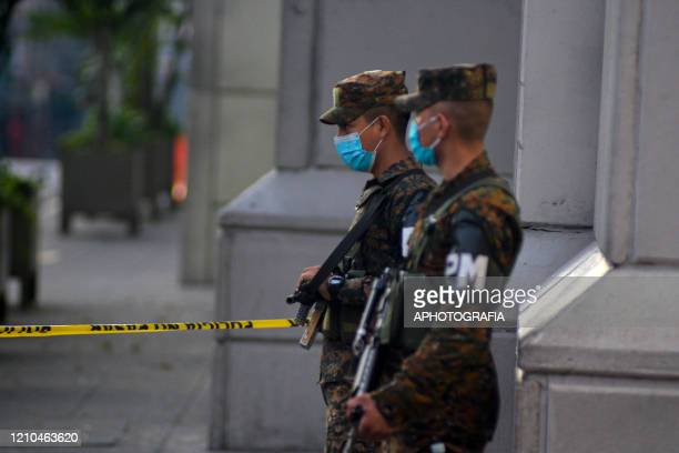 Soldiers guard the streets of downtown San Salvador to ensure people comply with the government issued measures during quarantine amid COVID-19...