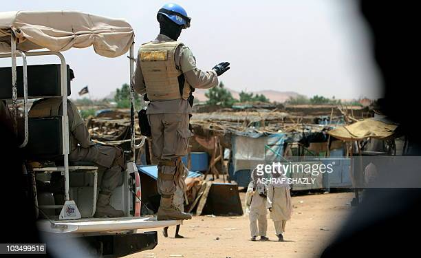 Soldiers guards a high-level meeting of Chinese, Russian, European, United Nations and African Union officials in El-Fasher, the capital of North...