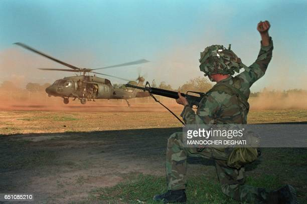 A US soldiers guides a military helicopter during an operation against a military command post loyal to General Manuel Noriega on December 23 1989 in...