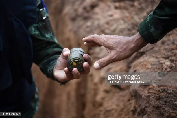 Soldiers handle antipersonnel mines before a controlled detonation at the official Destruction Ceremony of Thailands Retained AntiPersonnel Mines...