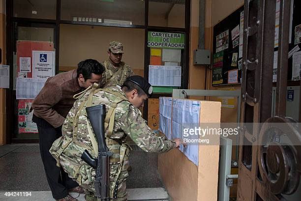 Soldiers help a voter find a polling station to cast his vote for president in Buenos Aires Argentina on Sunday Oct 25 2015 Argentina is moving a...