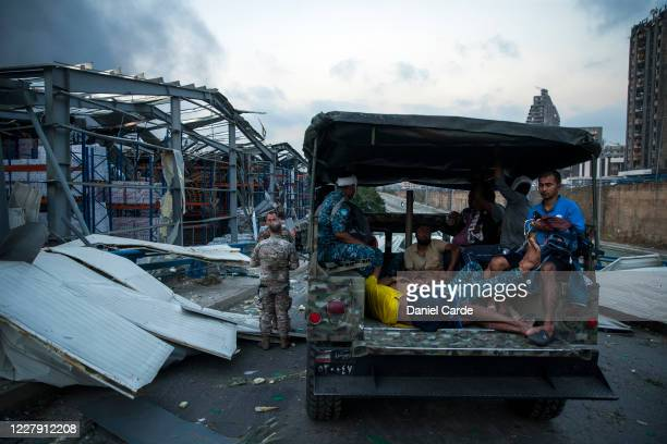 Soldiers help gather injured people after a large explosion on August 4, 2020 in Beirut, Lebanon. Video shared on social media showed a structure...