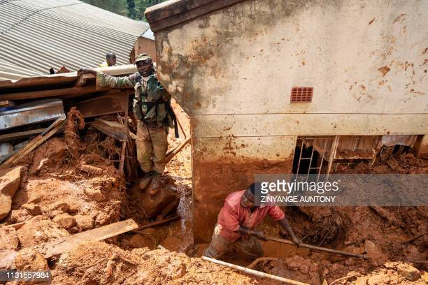 Soldiers help residents retrieve their lost belongings on March 19 2019 in Chimanimani as the military was deployed to assist civilians after the...