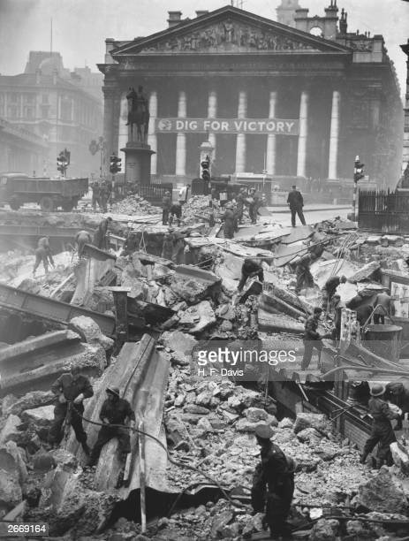 Soldiers help to clear the debris of Bank Underground Station in front of The Royal Exchange London the morning after receiving a direct hit during...
