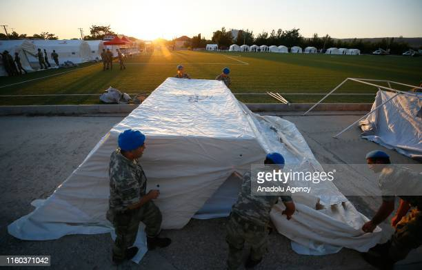 Soldiers help to set up tents for people whose house were damaged on earthquake at Bozkurt Stadium by Turkeys Disaster and Emergency Management...