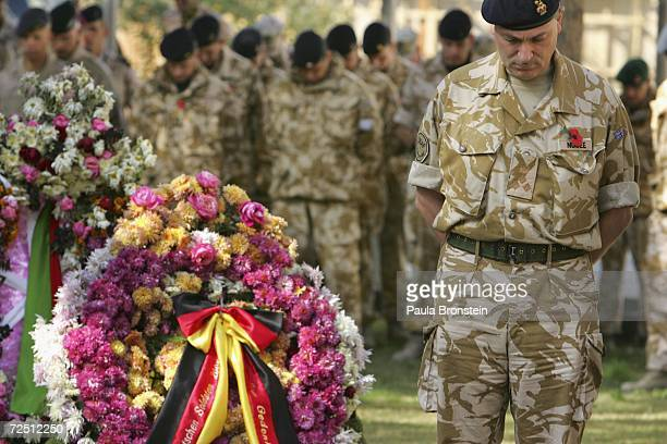 soldiers honour those who served and died in war during a Service of Remembrace at the ISAF headquarters in Kabul Afghanistan November 12 2006...