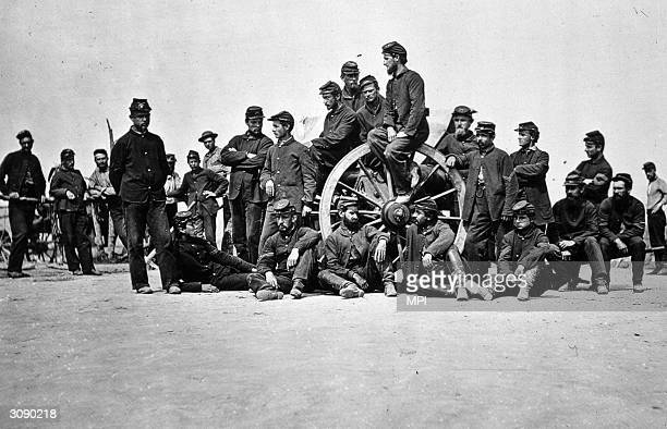 Soldiers in a burial party at Cold Harbour rest on a gun carriage