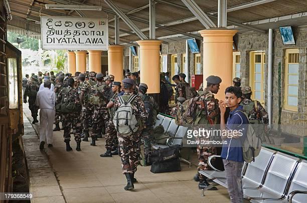 Soldiers in a crowded train station near Kandy, Sri Lanka