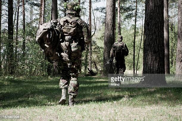 soldiers in a forest - british culture stock pictures, royalty-free photos & images