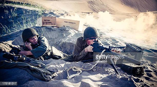 wwii soldiers in a foxhole with explosions nearby - world war ii stock pictures, royalty-free photos & images