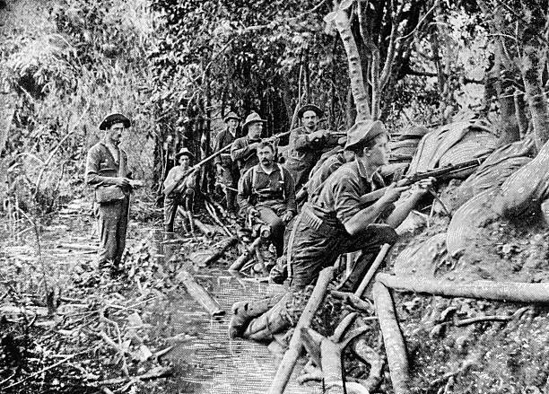 US soldiers in a trench near Manila during the Spanish-American...