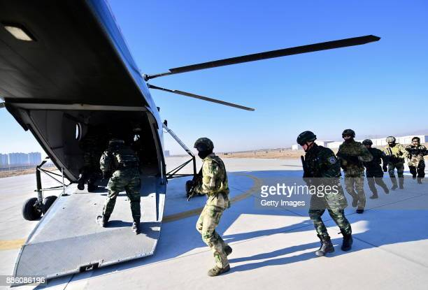 Soldiers in action during a drill on day three of the ChinaRussia counterterrorist Cooperation2017 on December 5 2017 in Yinchuan Ningxia Hui...