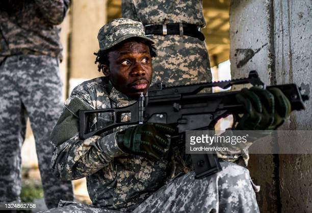 soldiers in action - military invasion stock pictures, royalty-free photos & images