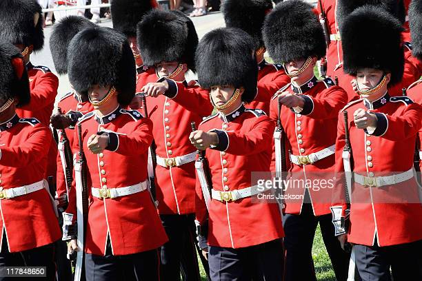 Soldiers in bearskins march during Canada Day Celebrations as they wait to catch a glimpse of Prince William, Duke of Cambridge and Catherine,...