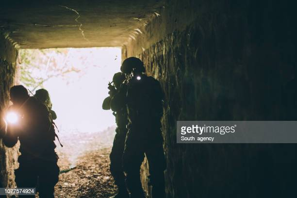 soldiers in dark cave - military training stock pictures, royalty-free photos & images