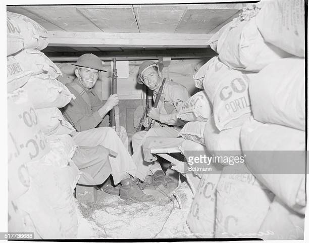 Soldiers in dugout commonly referred to as rat hole are left to right Private First Class Lionel Cota of St Albans Vermont and PFC AM Cheney of Lubec...