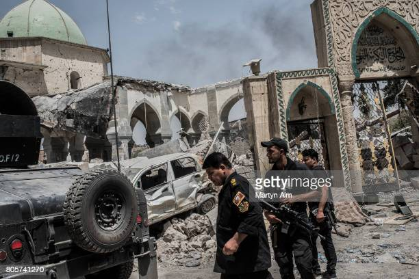 ISOF soldiers in front of the destroyed alNuri mosque in the Old City district where heavy fighting continues on July 2 2017 in Mosul Iraq Iraqi...