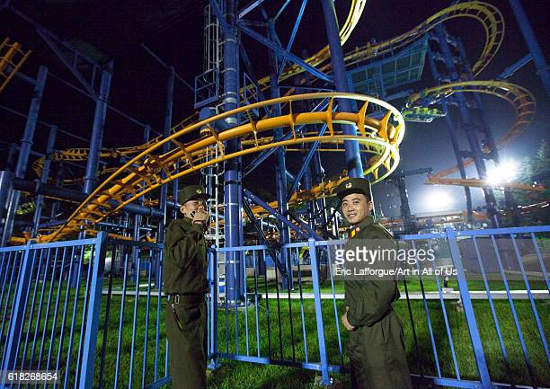 Soldiers in front of the roller coaster at kaeson youth park pyongyang North Korea on September 9 2012 in Pyongyang North Korea