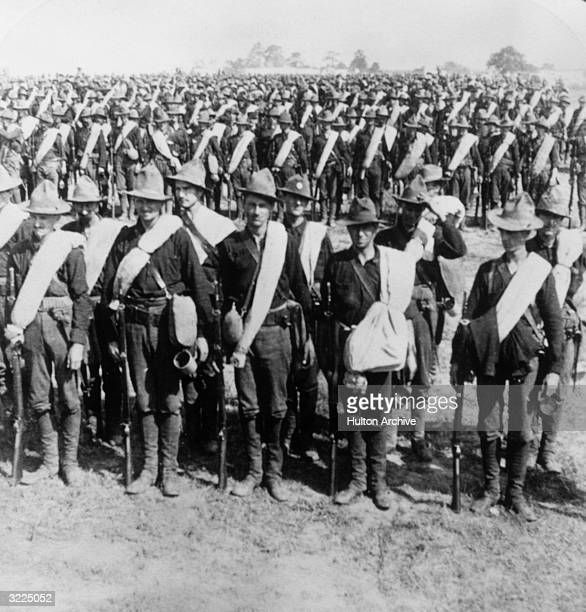 Soldiers in General Miles's Puerto Rican Army stand at attention before leaving for the SpanishAmerican War Newport News Virginia