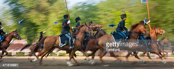 soldiers in historical uniform on horseback simulating a cavalry charge - cavalry stock pictures, royalty-free photos & images