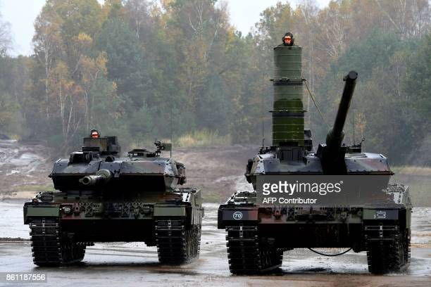 Soldiers in Leopard 2 A7 main battle tanks of the German armed forces Bundeswehr drive in the context of an informative educational practice 'Land...