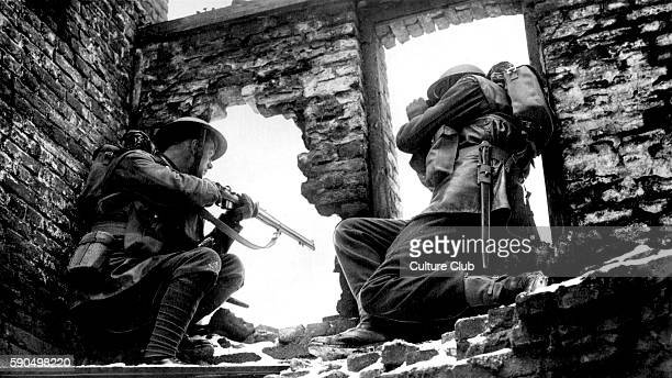 Soldiers in ruined building looking through a window, one pointing a gun, the other looking through binoculars. Caption reads: 'Where their fathers...