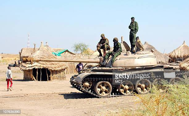 Soldiers in South Sudan's former rebel Sudan People's Liberation Army lounge atop a Soviet-era battle tank just miles from the front lines of the...