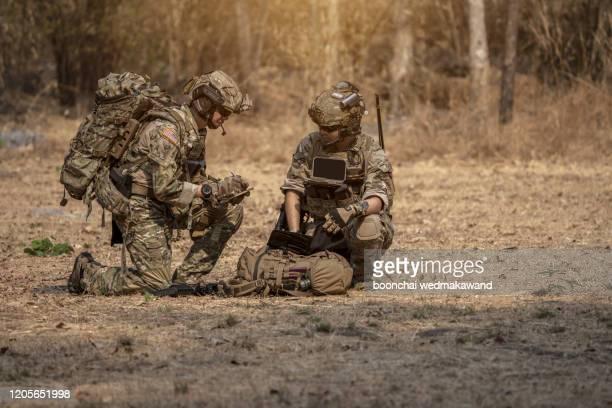 soldiers in special forces, army soldier in protective combat uniform holding special operations forces combat assault rifle. - infantry stock pictures, royalty-free photos & images