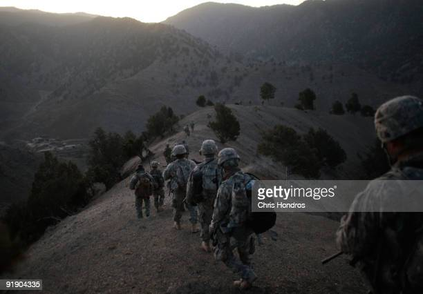 Soldiers in the 1/501st of the 25th Infantry Division file off the ridge of a mountain where they spent the night in a Taliban stronghold area...